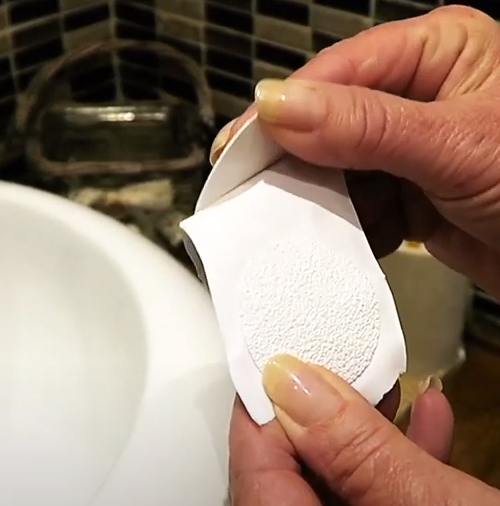 Peeling anti slip bath sticker off backing